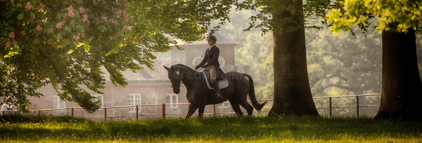 Houghton international horse trials May 2017. HOUGHTON, NORFOLK/ENGLAND - May 25th 2017: Houghton International Horse Trials 2017 with Chloe Lynn on Calzini royalty free stock photography
