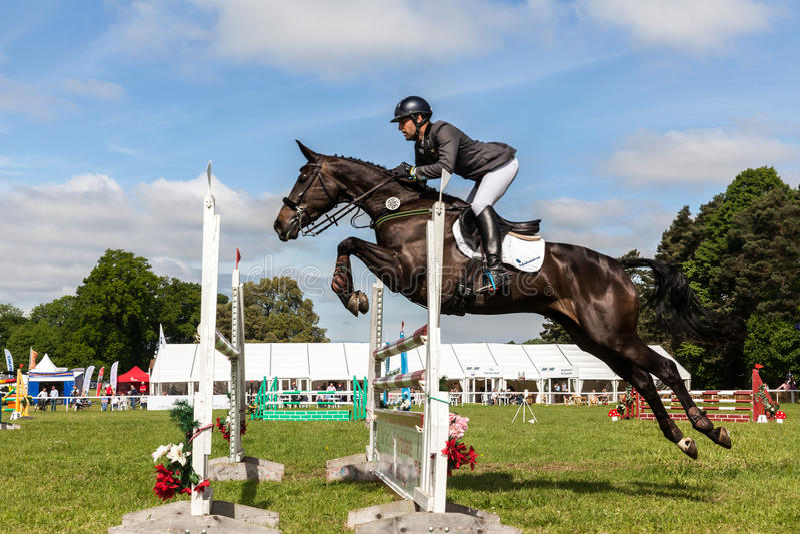 Houghton international horse trials May 2017. HOUGHTON, NORFOLK/ENGLAND - May 28th 2017: Houghton International Horse Trials 2017 Wayne Garrick riding Uptown royalty free stock photos