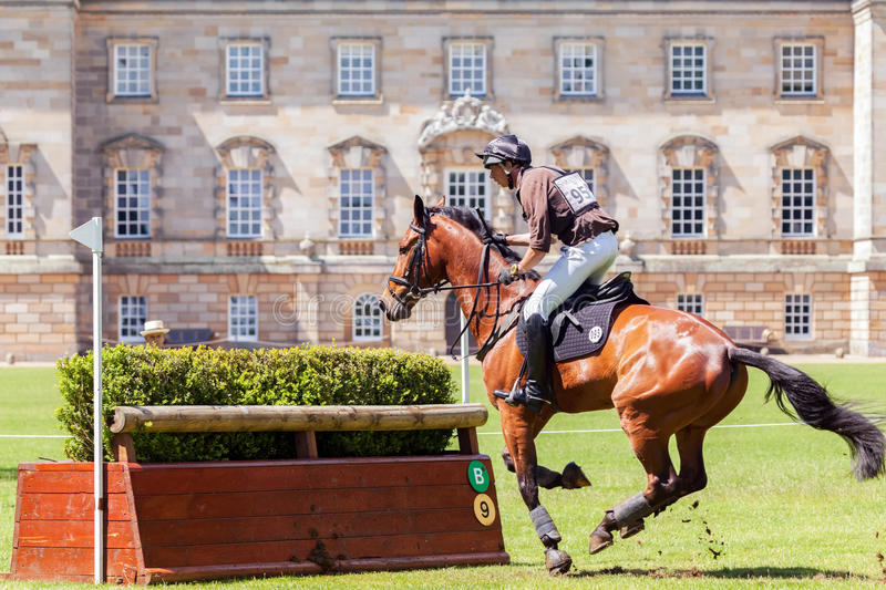 Houghton international horse trials Richard P Jones. HOUGHTON, NORFOLK/ENGLAND - May 25th 2017: Houghton International Horse Trials 2017 Richard P Jones riding royalty free stock photography