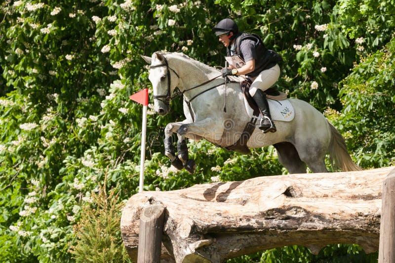 Houghton international horse trials Rosie Thomas riding Heat Wave. HOUGHTON, NORFOLK/ENGLAND - May 25th 2017: Houghton International Horse Trials 2017 Rosie stock photos