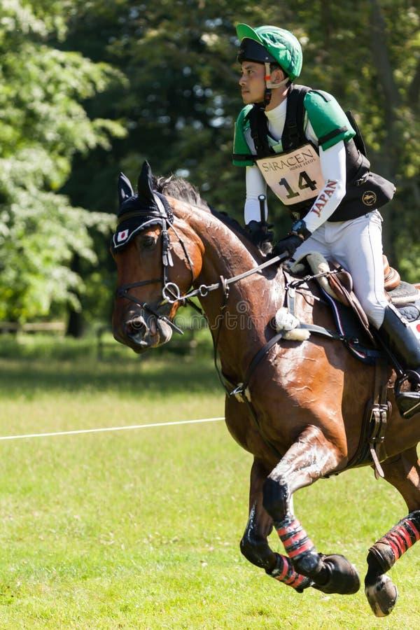 Houghton international horse trials Ryuzo Kitajima riding Feroza Nieuwmoed. HOUGHTON, NORFOLK/ENGLAND - May 25th 2017: Houghton International Horse Trials 2017 royalty free stock image