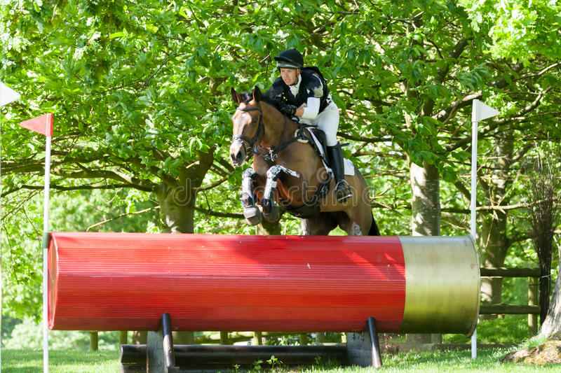 Houghton international horse trials Scott Wallace. HOUGHTON, NORFOLK/ENGLAND - May 25th 2017: Houghton International Horse Trials 2017 Scott Wallace riding Over royalty free stock photos