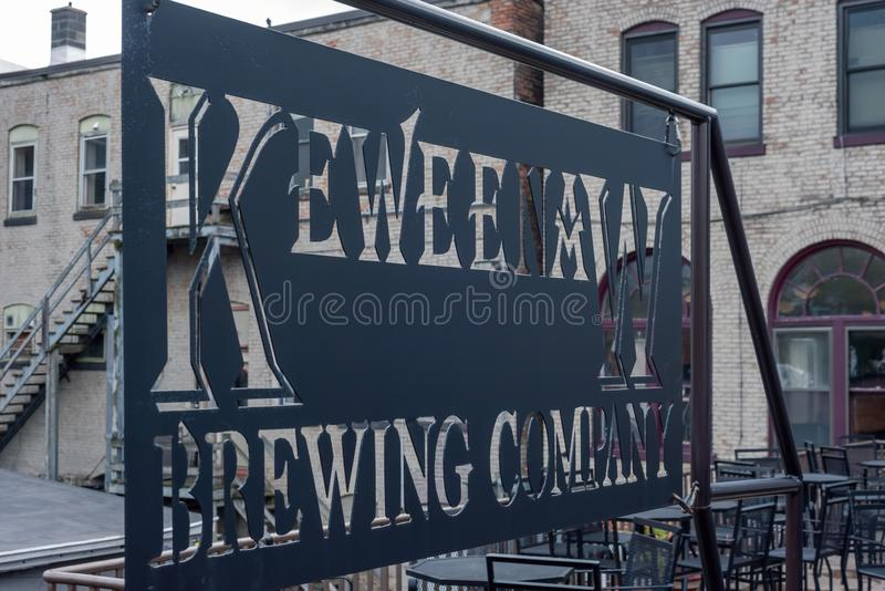 Houghton, MI/USA - 10-06-2018: Keweenaw Brewing Company outdoor patio. Houghton, MI/USA - 10-06-2018: Keweenaw Brewing Company sign and outdoor patio stock photography