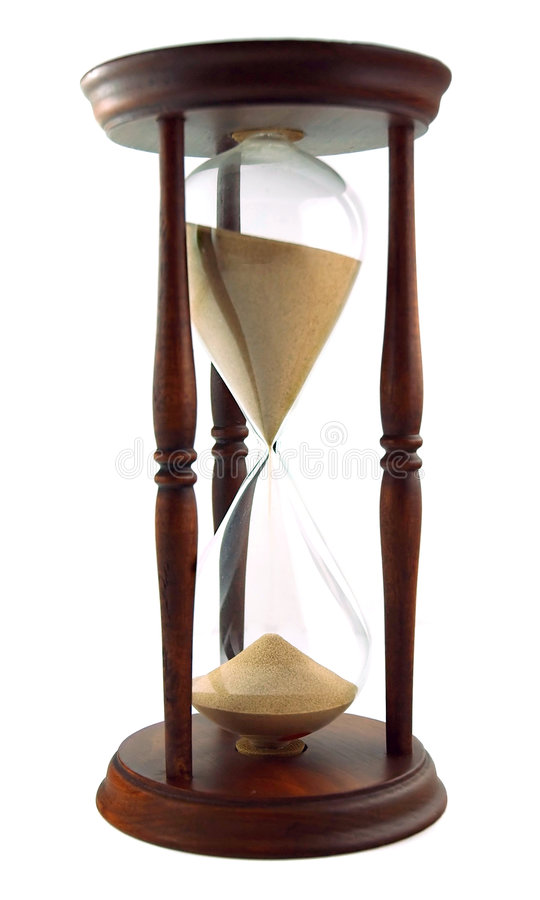 Hour Glass on White. Antique hourglass against white