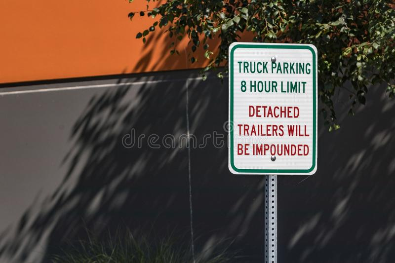 8 hour parking detached trailers will be impounded sign. In daylight stock photos