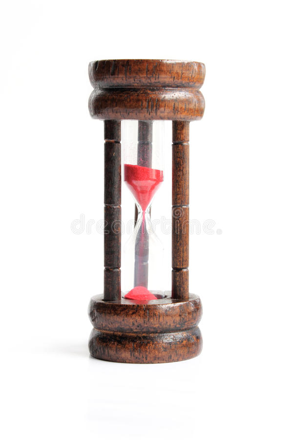 Hourglass antique - sandglass. A hourglass antique or sandglass on the white stock photo
