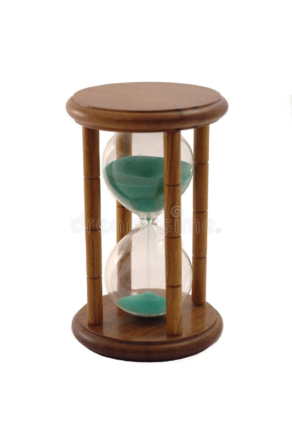 Hourglass. Is a symbol of time. On this picture it is enough time remaining stock images