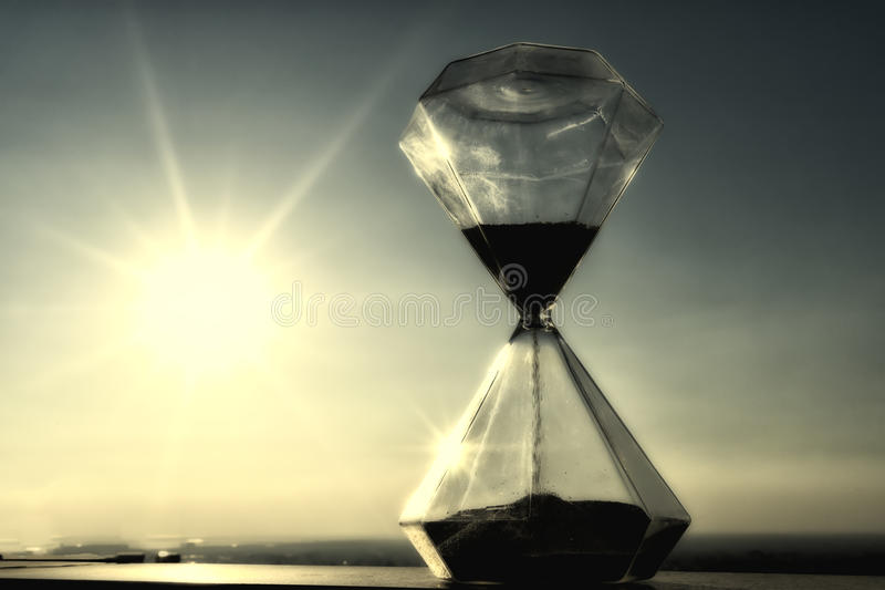 Hourglass on a background sunset.  stock photography