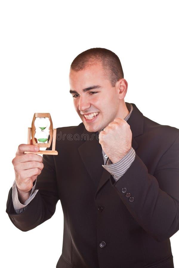 Hourglass bem sucedido da terra arrendada do homem de negócios fotos de stock royalty free