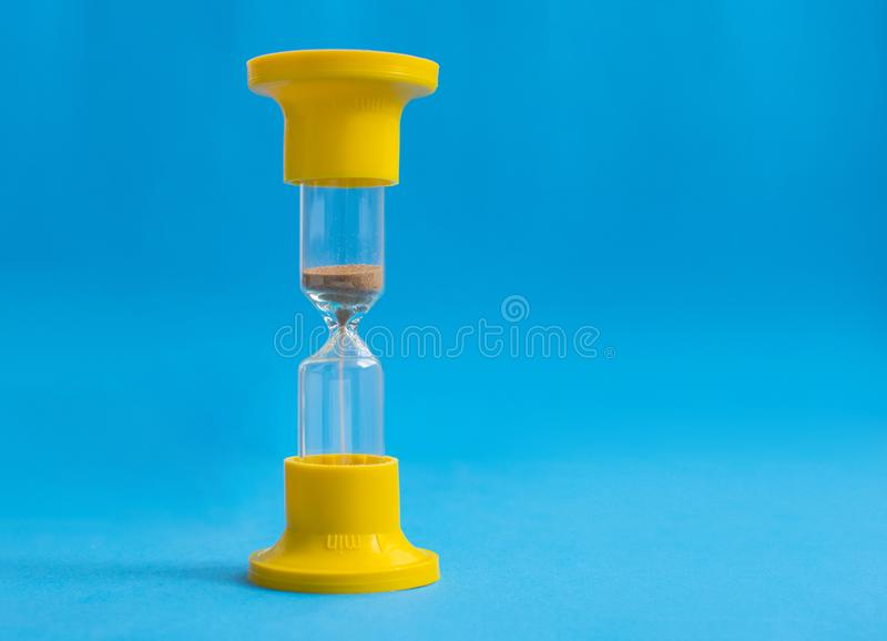 Hourglass on blue background stock images