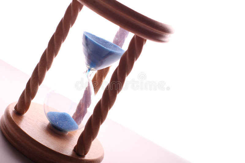 Hourglass blue sand stock images