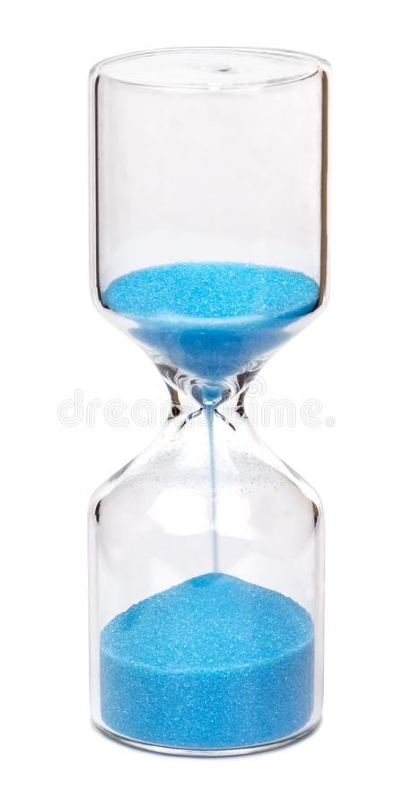 Hourglass with blue sand. Hourglass of cylindrical shape with blue sand, isolated on white background stock photography
