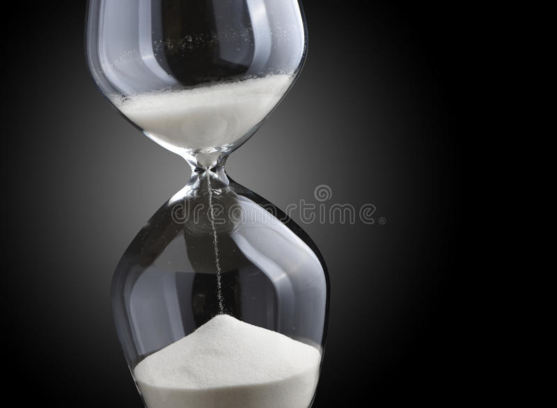 Hourglass. Closeup hourglass on black background royalty free stock image