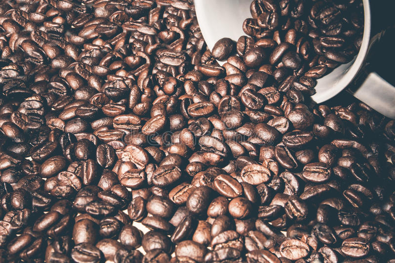 Hourglass in coffee beans stock images