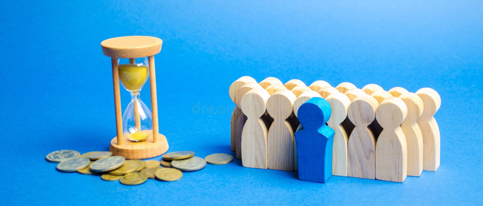 Hourglass, coins and a team of workers. Time management and distribution. Concept of saving money. Planning work. Business. Strategy and investment. Performance stock image