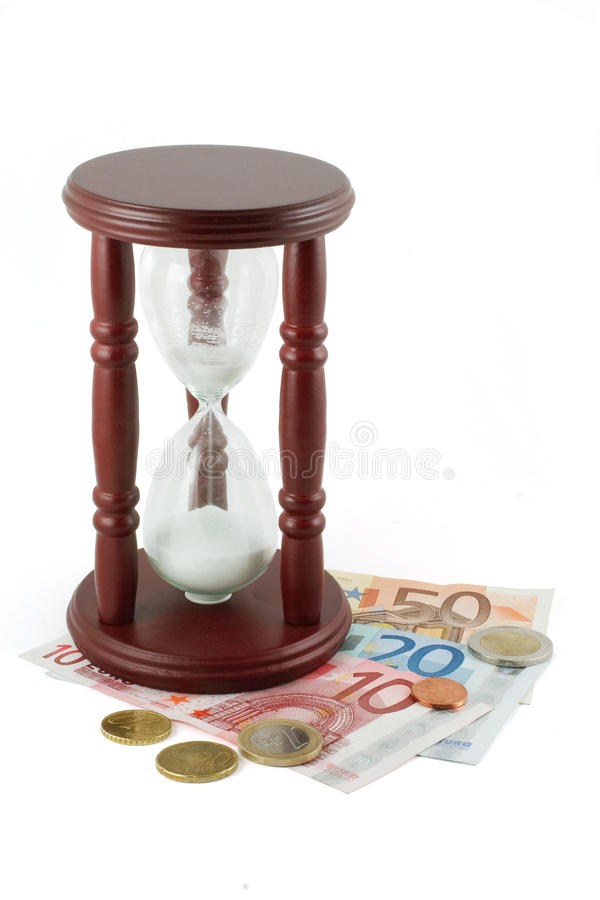Hourglass e dinheiro fotos de stock royalty free