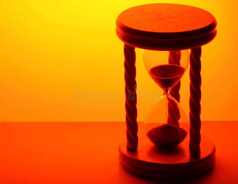 Hourglass in gold light stock photo