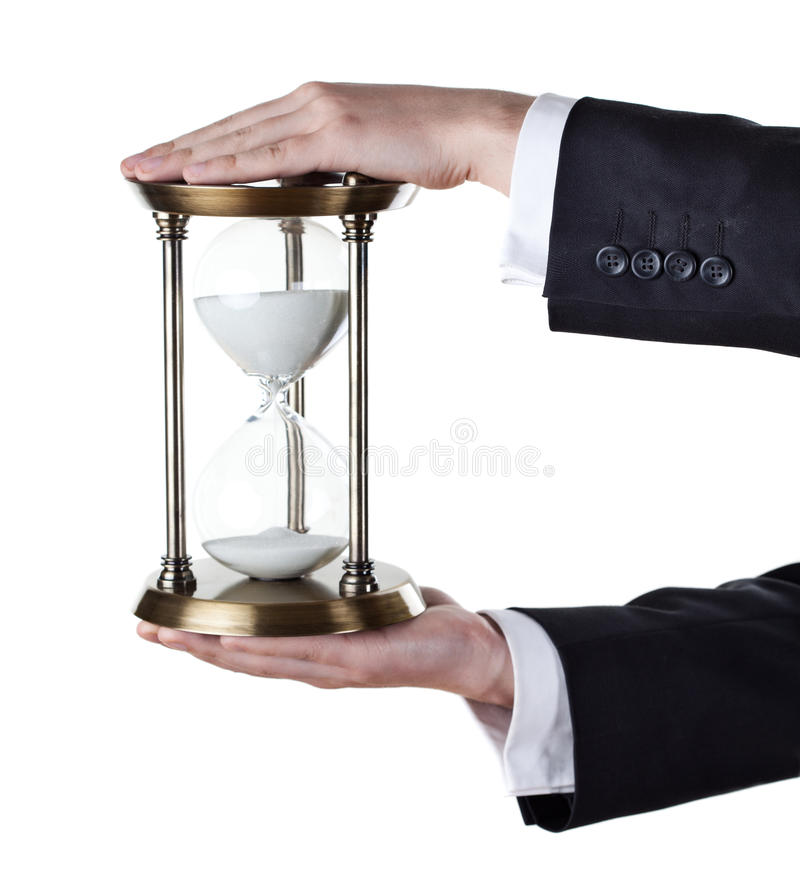 Hourglass in hand royalty free stock photo