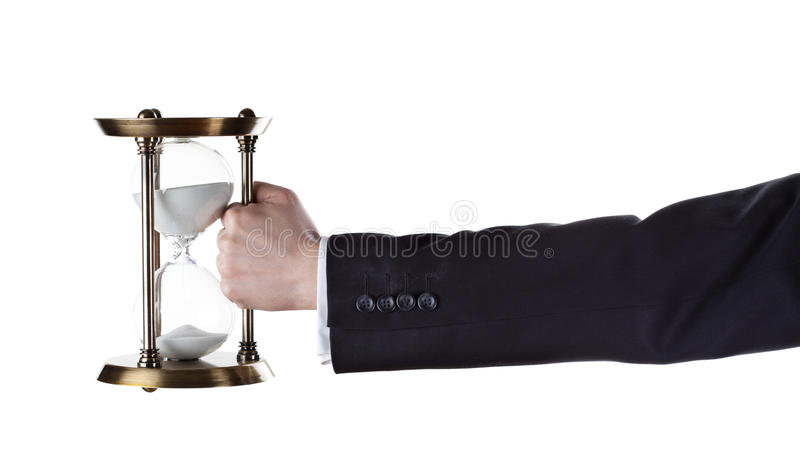 Hourglass in hand stock photography