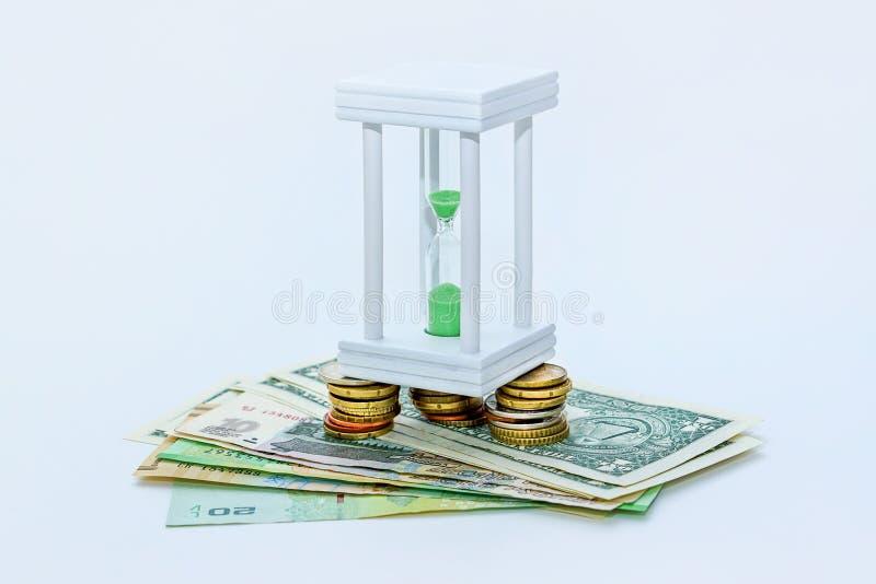 Hourglass i pieniądze fotografia royalty free