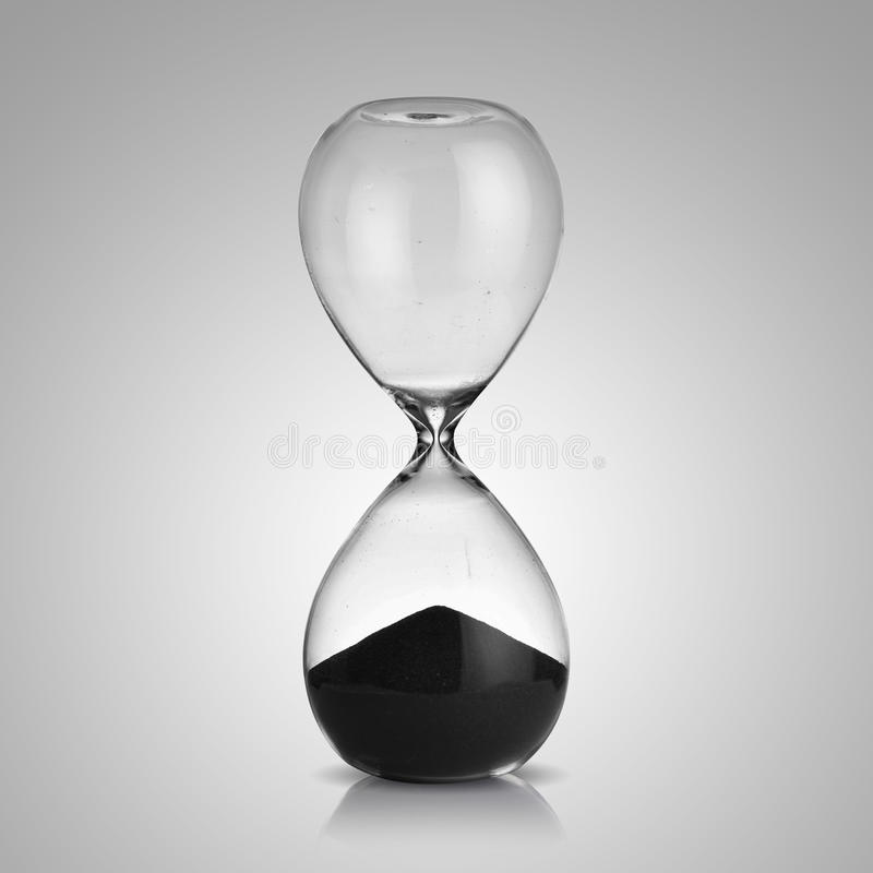 Hourglass. One hourglass on gray background stock photos