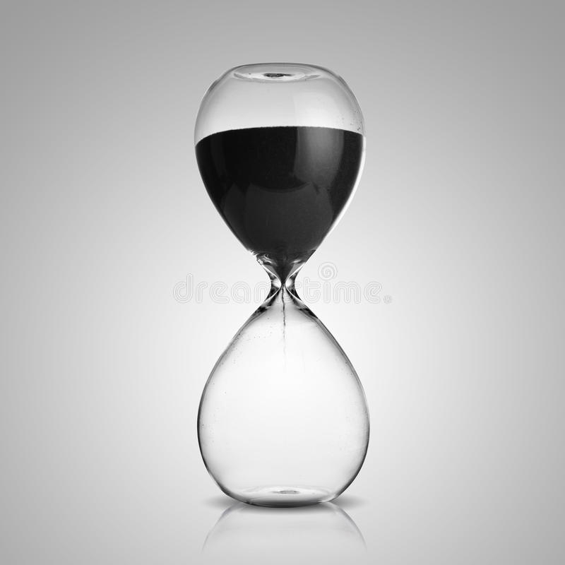 Hourglass. Photo of hourglass on gray background royalty free stock photos