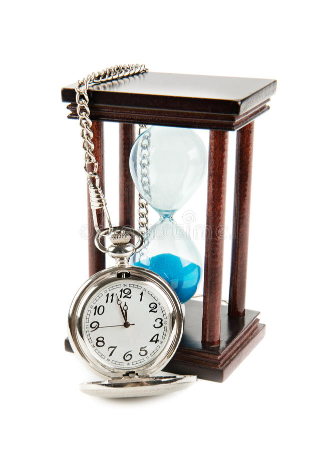 Hourglass and a pocket watch stock image