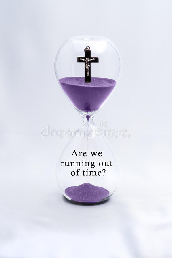Hourglass Religion Rapture. Hourglass concept of Rapture and time royalty free stock photos