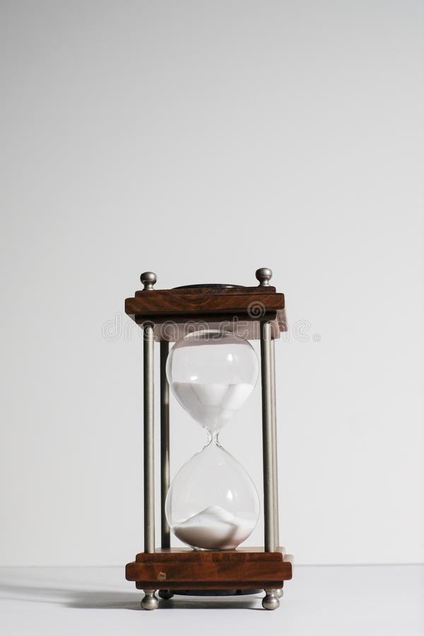 Hourglass, or sand clock isolated in white background. Hourglass, or sand clock is an old style time measurement, a symbol of the importance of meeting deadline royalty free stock image