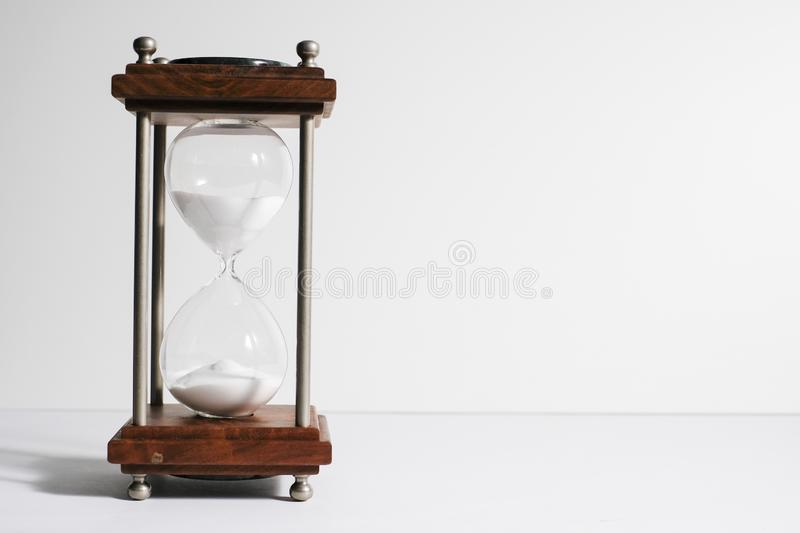 Hourglass, or sand clock isolated in white background. Hourglass, or sand clock is an old style time measurement, a symbol of the importance of meeting deadline royalty free stock photography