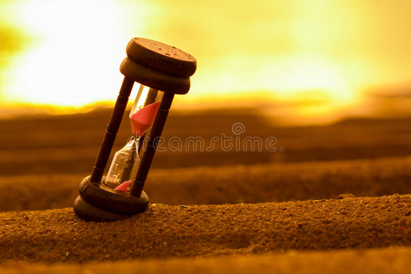 HOURGLASS ON THE SAND stock photo