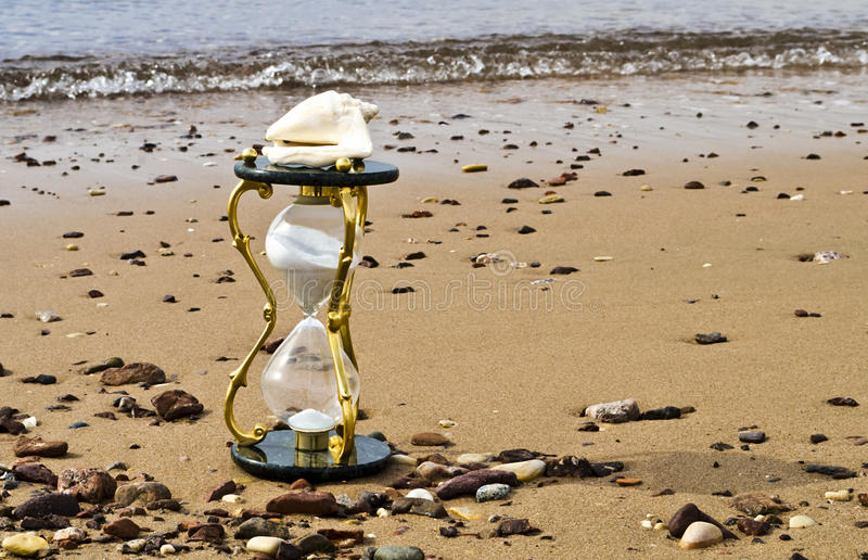 Download Hourglass On Sandy Background Stock Photo - Image: 23292528