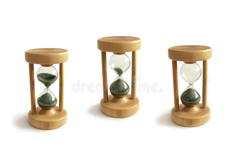 Hourglass sequence. Hourglass on three different moments, running out of time, isolated on white royalty free stock photos