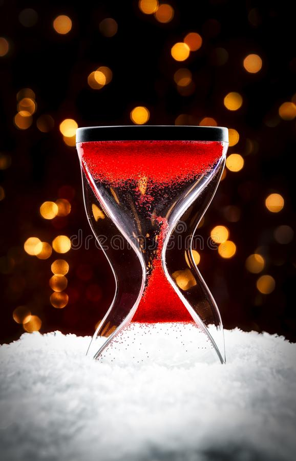 Hourglass in the snow royalty free stock photography