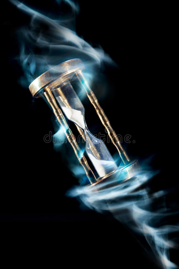 Hourglass, time concept with a high contrast image. Dramatic lit image of hourglass, time concept royalty free stock photography