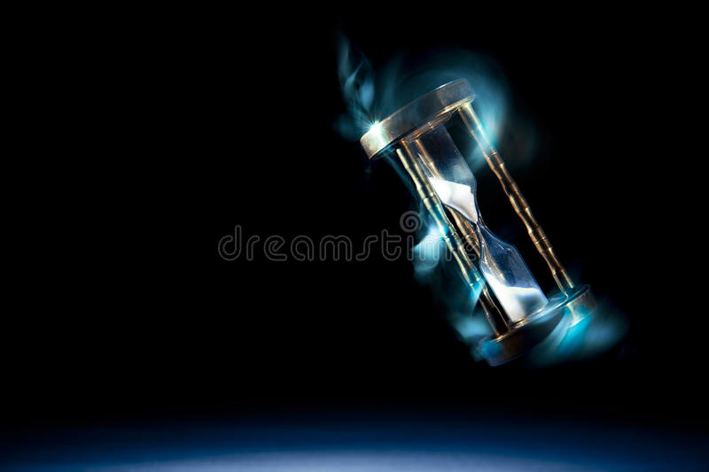 Hourglass, time concept with a high contrast image. Dramatic lit image of hourglass, time concept stock photo