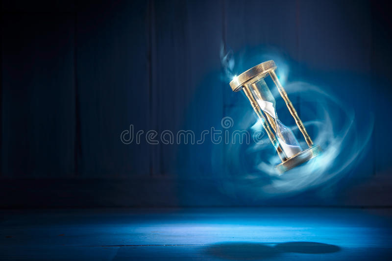 Hourglass, time concept with a high contrast image. Dramatic lit image of hourglass, time concept royalty free stock photo