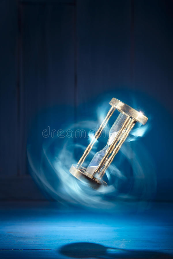 Hourglass, time concept with a high contrast image. Dramatic lit image of hourglass, time concept stock photos