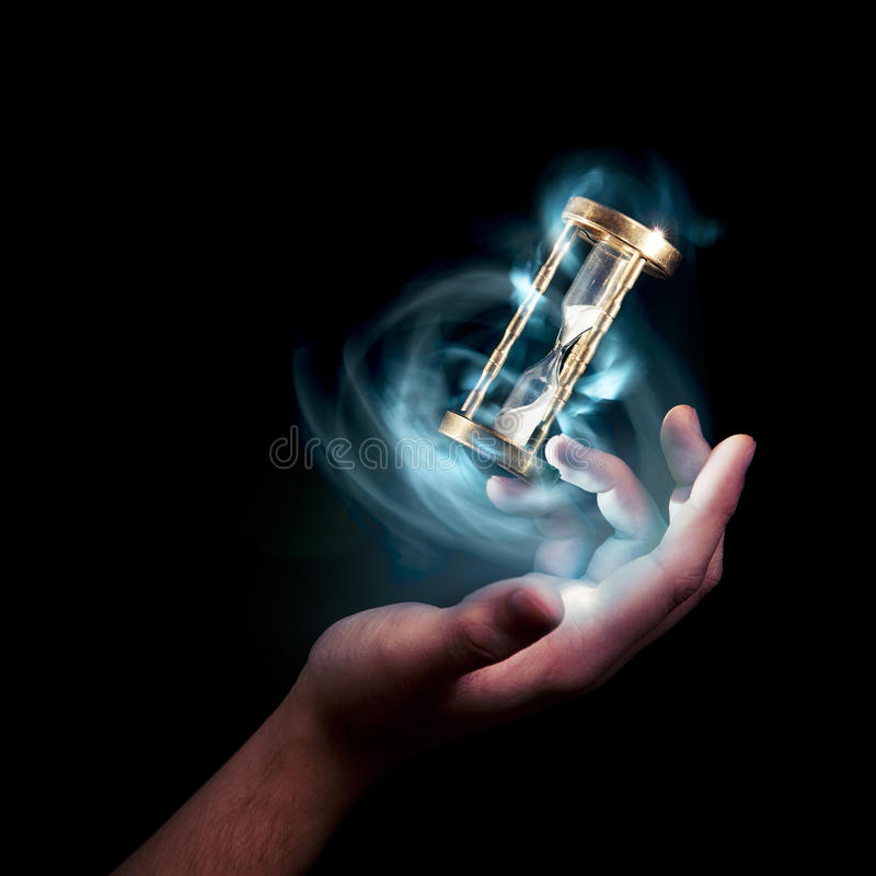 Hourglass, time concept with a high contrast image. Dramatic lit image of hourglass, time concept stock image