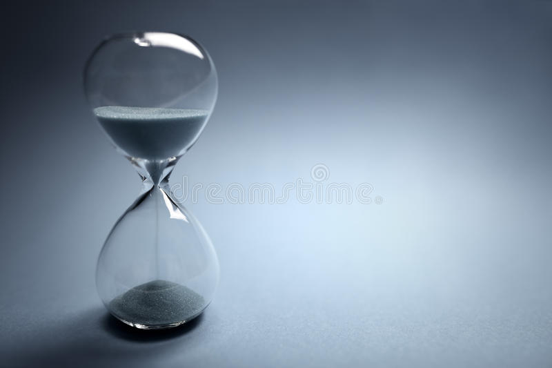 Hourglass time passing stock photography