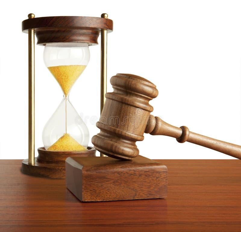 Hourglass und Hammer stockfoto