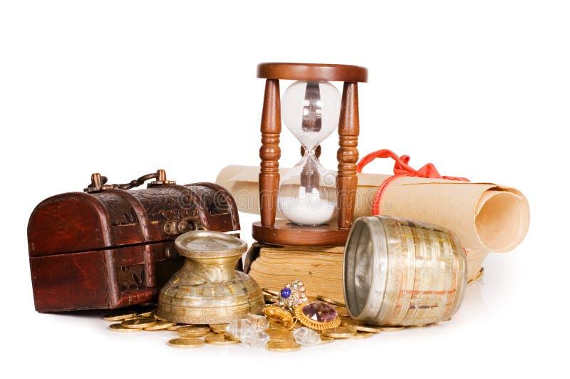Hourglasses e estilo do vintage da moeda foto de stock