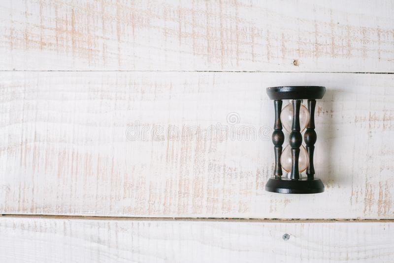 Hourglasses lie on a wooden table. top view. layflat. royalty free stock image