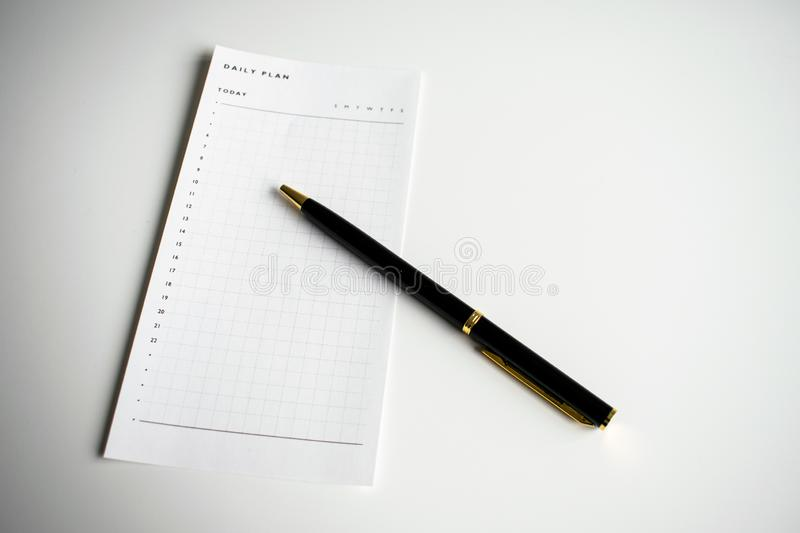 Hourly daily plan to do list with black pen stock image