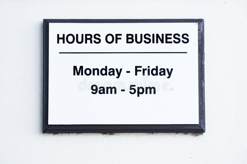 Hours of business sign Monday to Friday. Uk stock photo