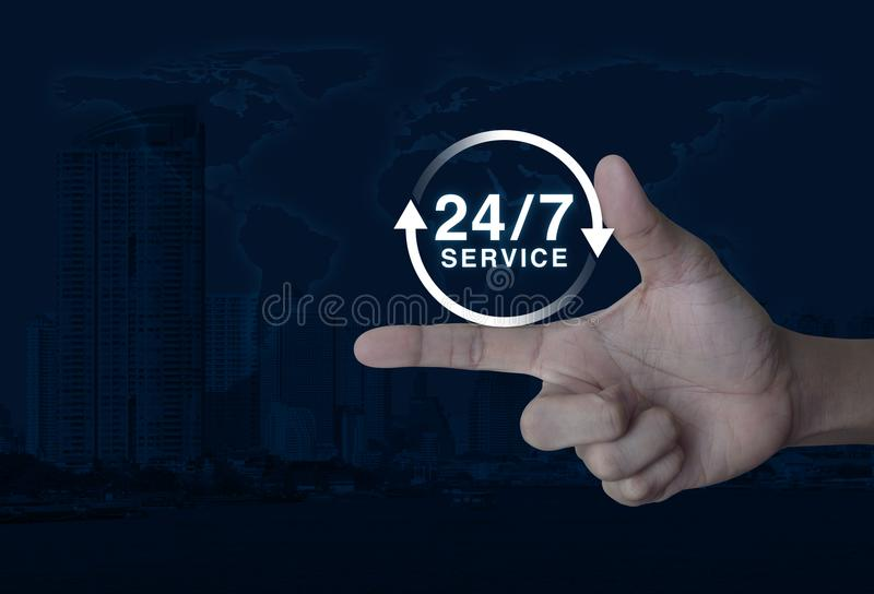 Full time service concept, Elements of this image furnished by N. 24 hours service icon on finger over world map and modern city tower, Full time service concept stock photo