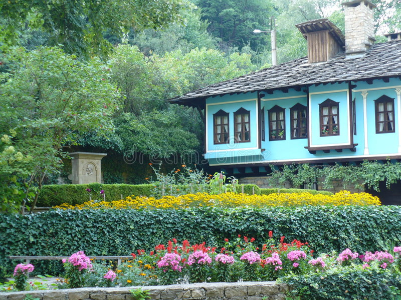 House. Old house with the flower garden royalty free stock photos