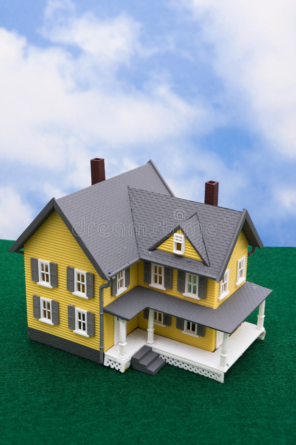 House. Sitting on grass with sky background stock photo