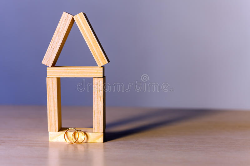 House abstract background. With golden rings for proposing stock photography