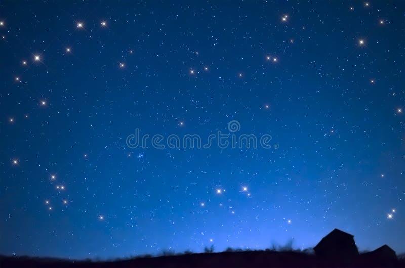 The house against the star sky stock photo